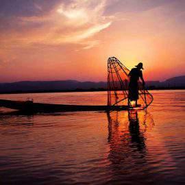 A fisherman at sunset